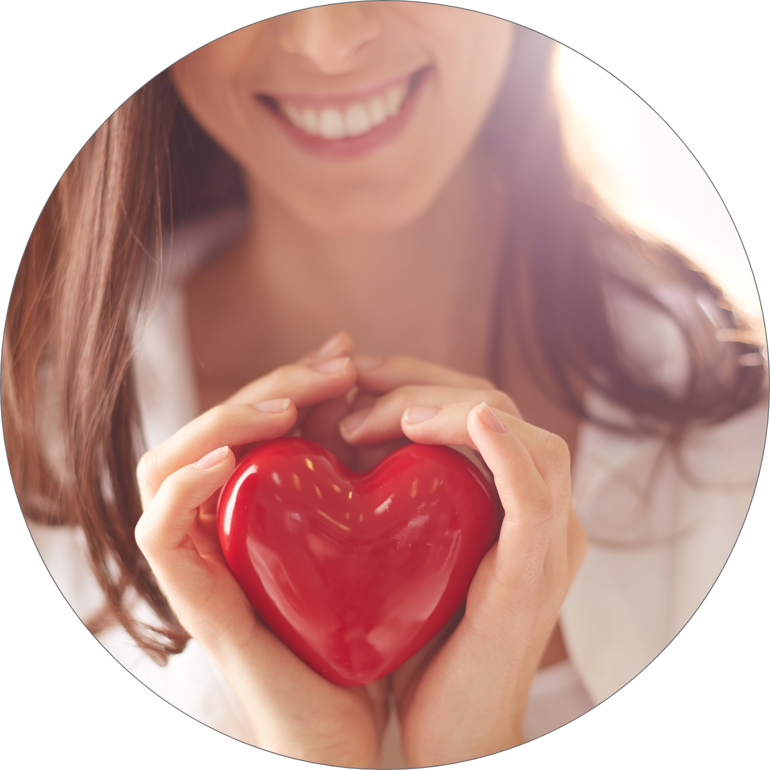 Smiling woman holding a red heart